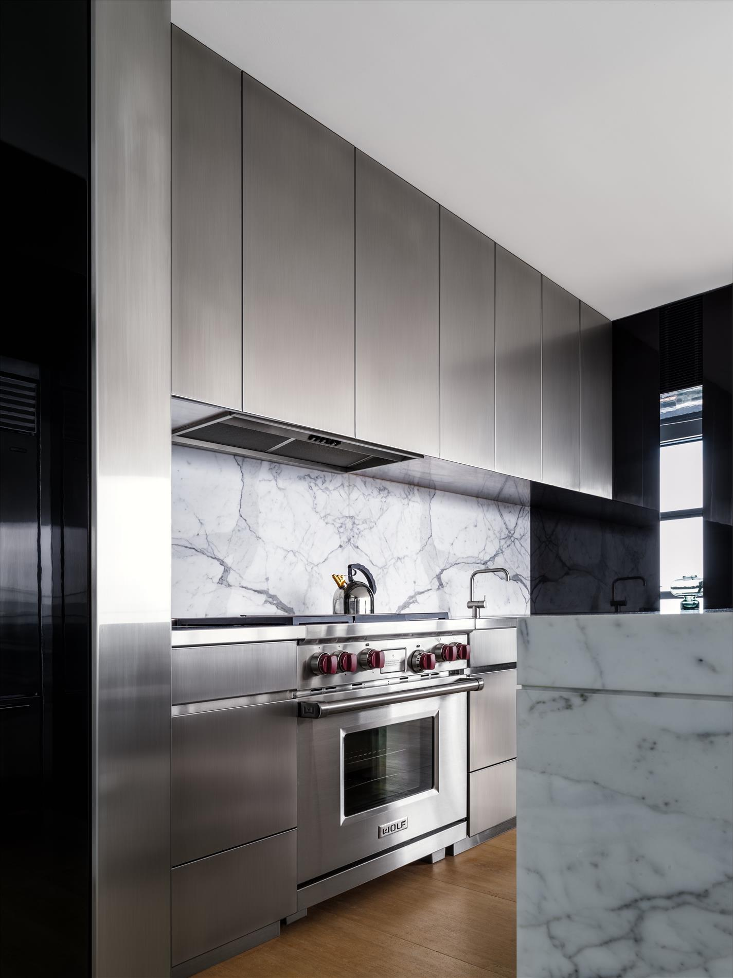 Calacatta marble and reflective surfaces round out the material palette.
