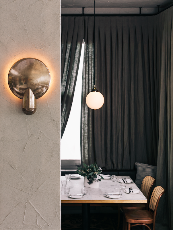 Surface wall sconce at the Paddington Inn, Sydney, designed by George Livissianis.
