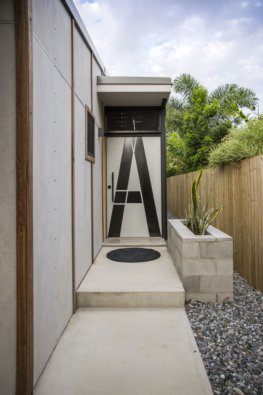 The side entry of Laneway house in Townsville unlocks the narrow floor plan and addresses its laneway condition.