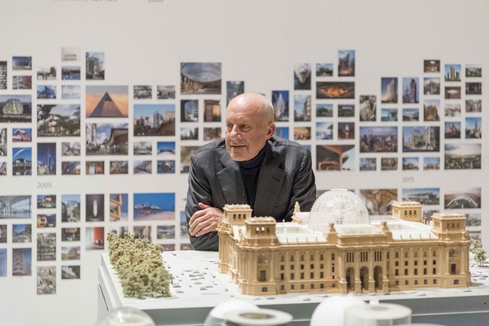 Norman Foster with a model of the Reichstag. Image by Nigel Young.