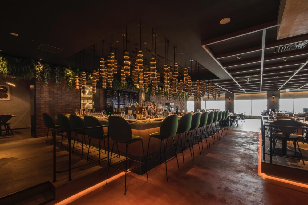 Hanging over the bar sits a bespoke light feature. Photo by Satoshi Matsuo.