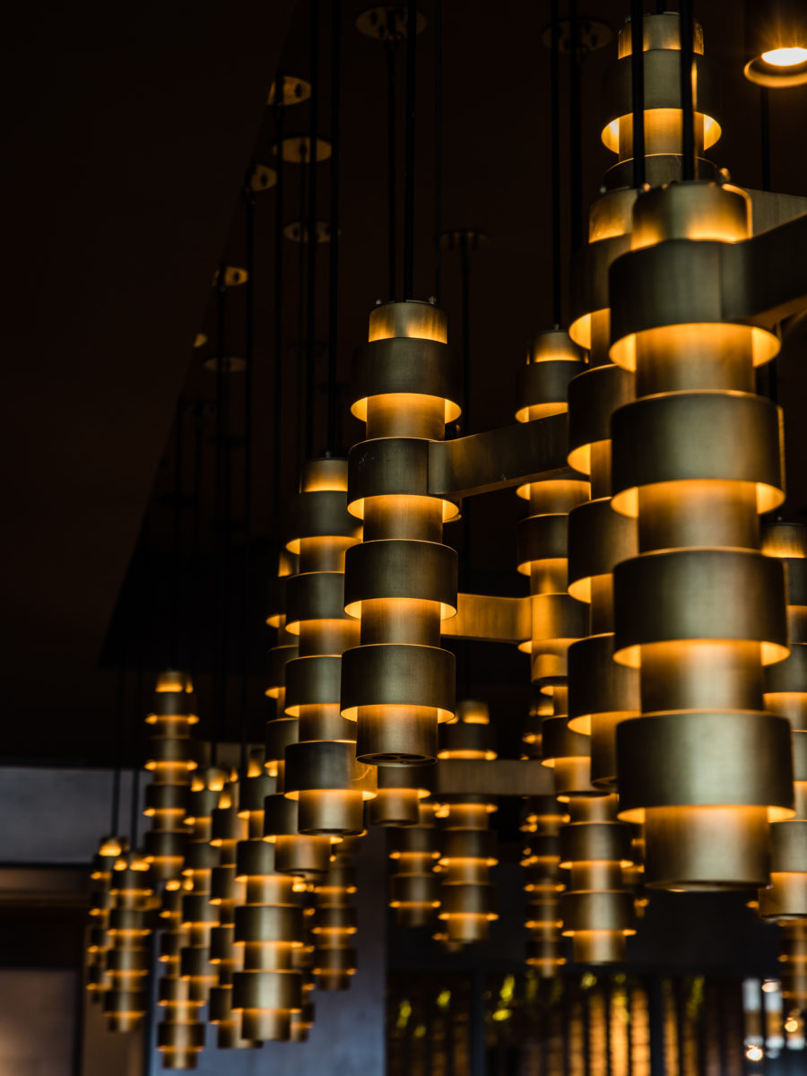 The custom light feature has mid century influences. Photo by Nikki To.