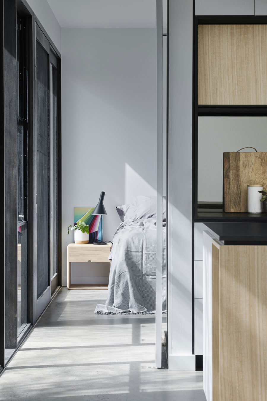 The bedroom can be closed off from the main living area with a large pivot door.