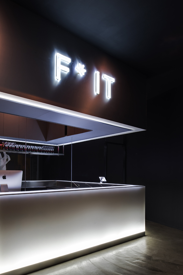 F*IT logo over the bar