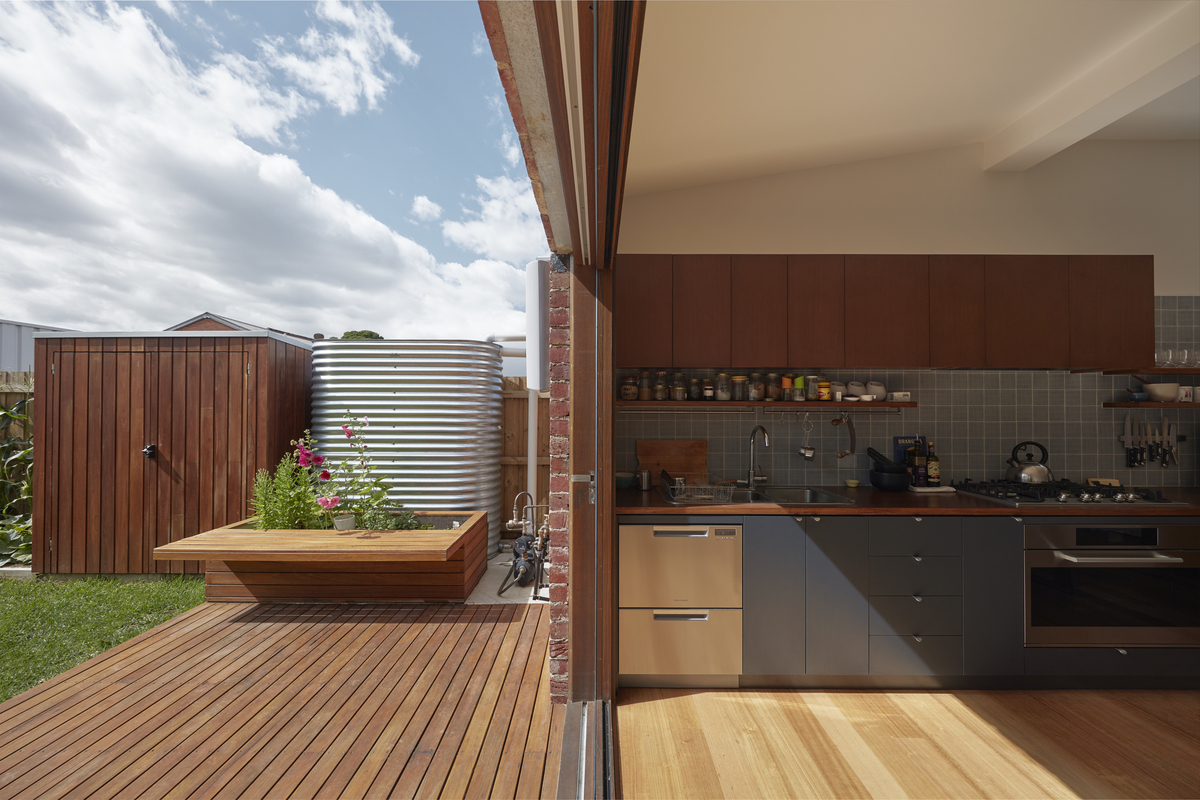The outdoor space and kitchen of a compact Melbourne home