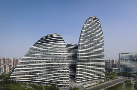 : Wangjing SOHO (2009–14) by Zaha Hadid Architects, photo by Virgile Simon Bertrand