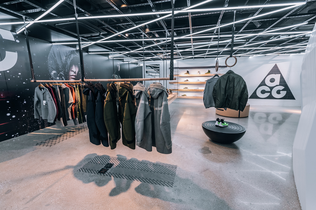 Clothing hangs from the roof in the Nike Lab store