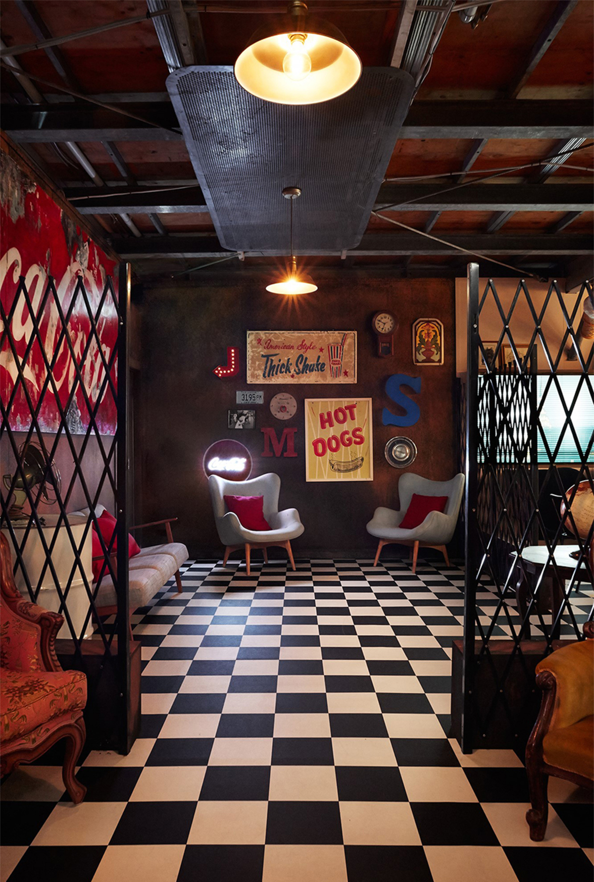 the black and white checker floor past the retro bar and through the rusty gates,