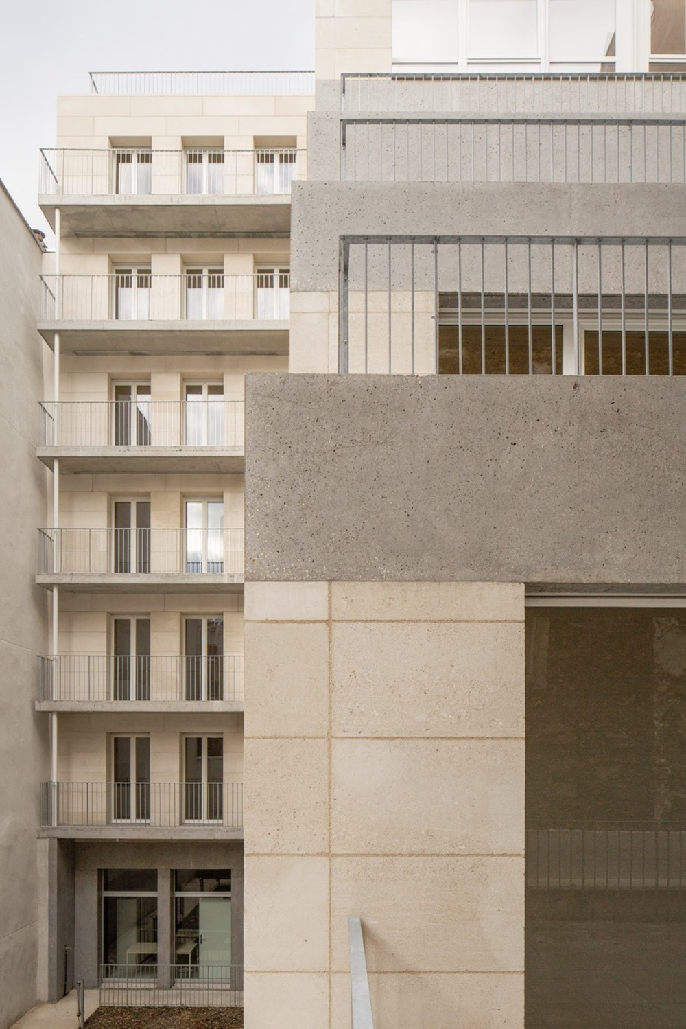 Stone social housing project by Barrault Pressacco