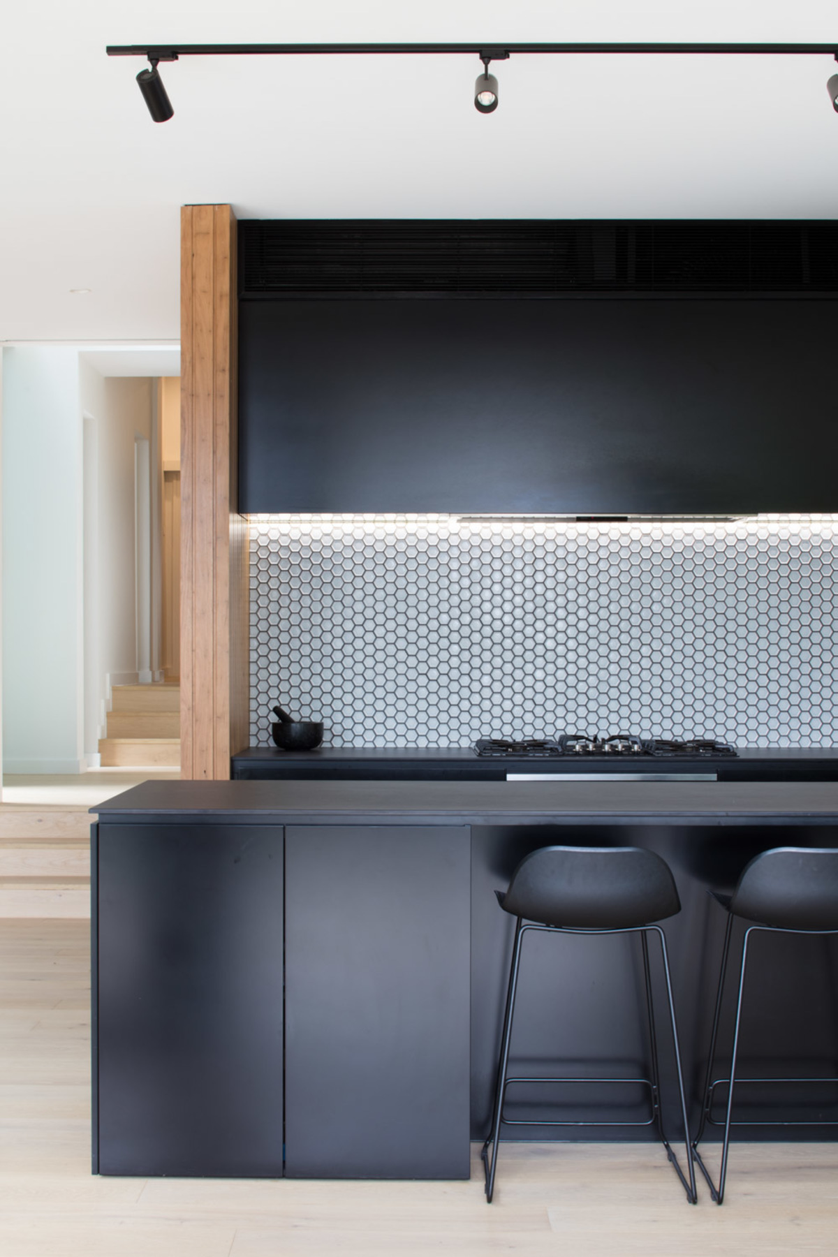 The kitchen in black and regular timber