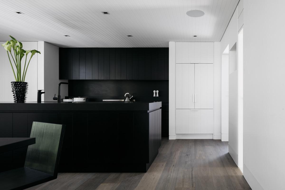 The kitchen uses a neutral colour palette