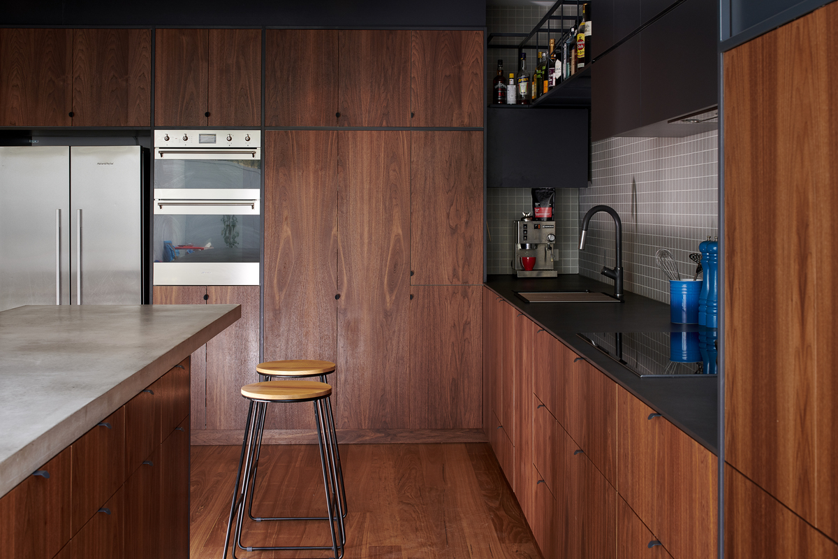 The kitchen is made from wood and steel