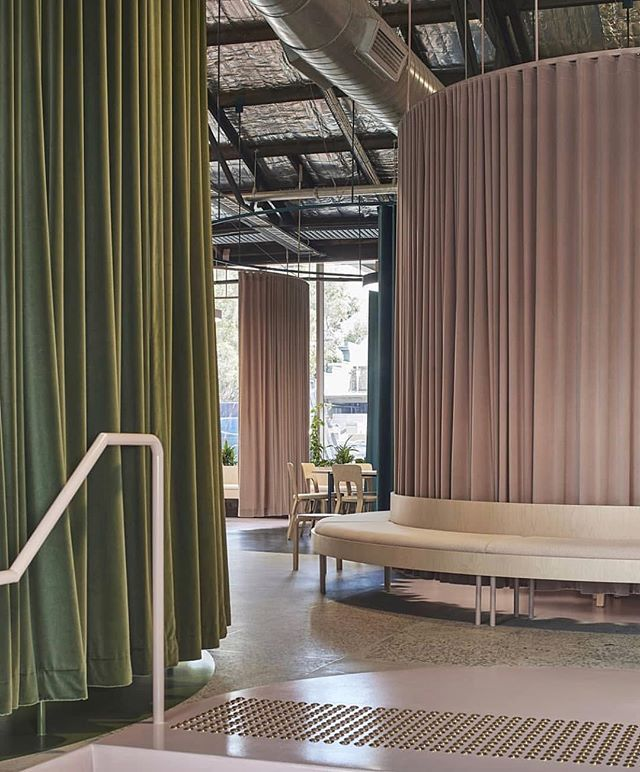 Fluid, curtained spaces define the office