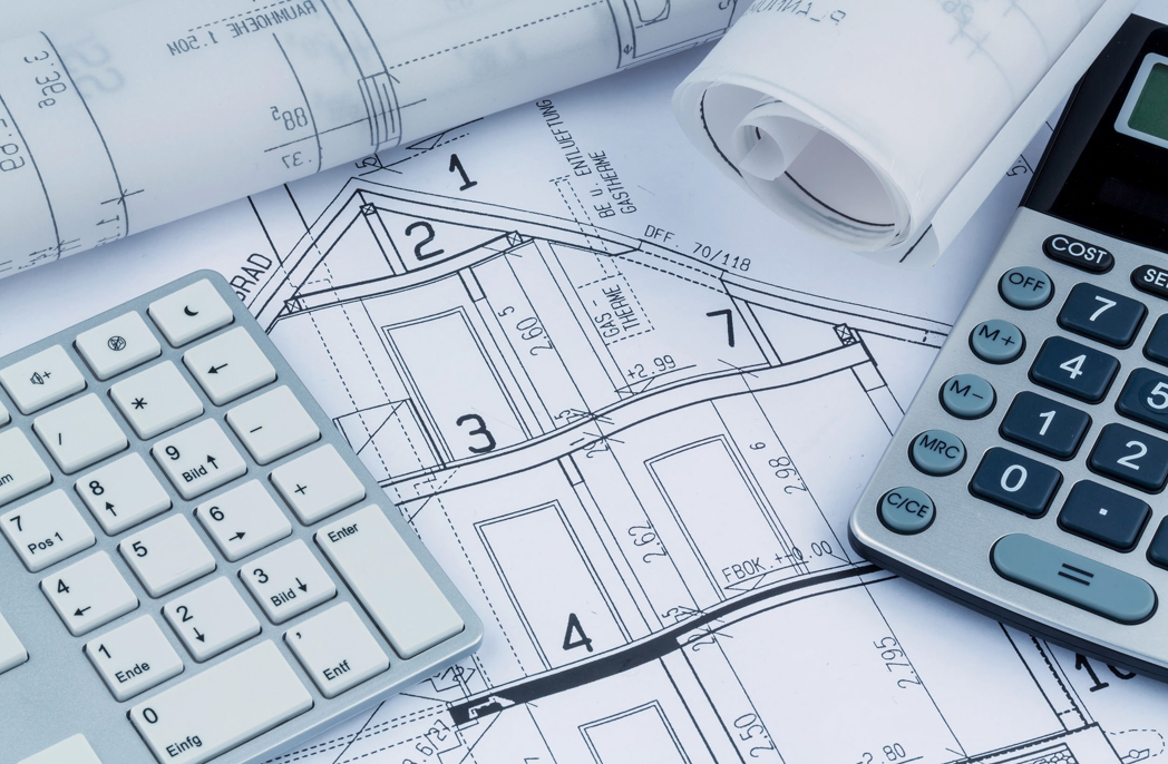 a blueprint of an architect with a calculator