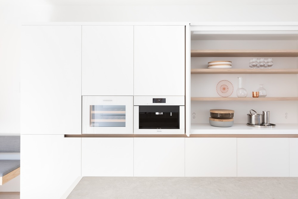 White lacquer millwork with integrated wine & coffee appliances