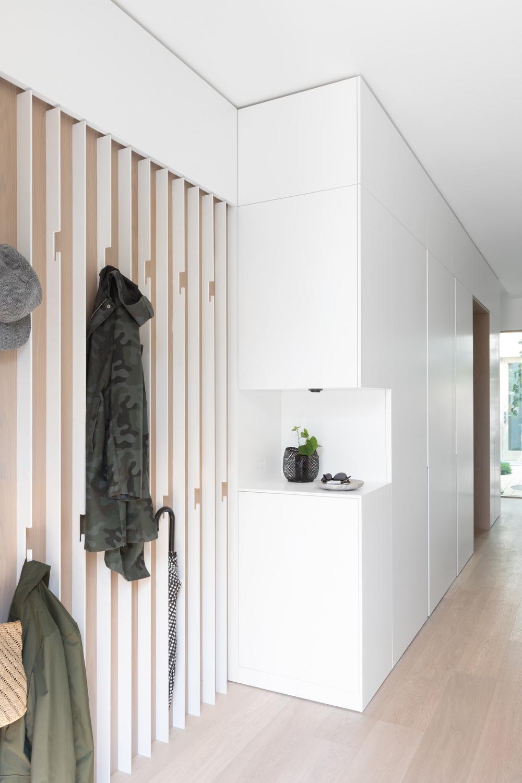 Entry with bespoke slatted steel coat hook wall