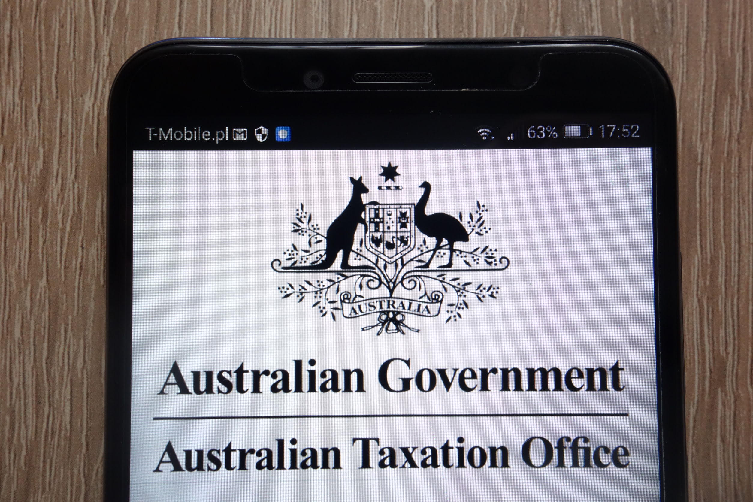 114452467 - konskie, poland - september 06, 2018: australian government - australian taxation office logo displayed on a modern smartphone