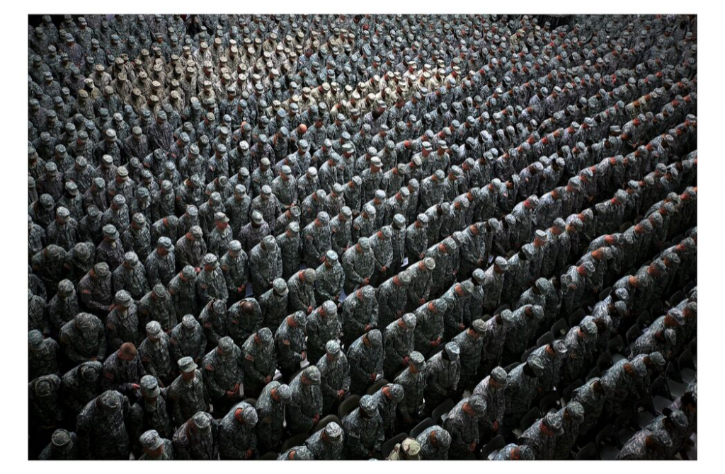 Ashley Gilbertson 1,215 American soldiers, airmen, Marines and sailors pray before a pledge of enlistment on July 4, 2008, at a massive re-enlistment ceremony at one of Saddam Hussein's former palaces in Baghdad, Iraq 2008 from Whiskey Tango Foxtrot series type C photograph 69.0 x 94.0 x 5.5 cm Courtesy of the artist © Ashley Gilbertson / VII Network