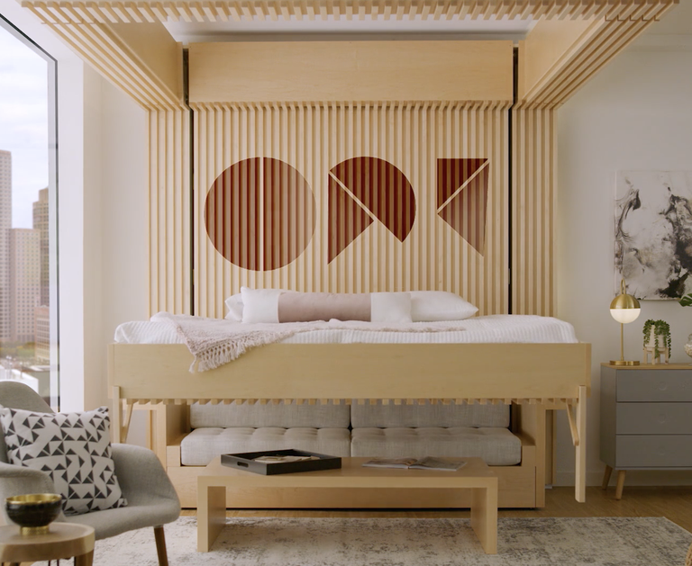 The Ori 'Cloud Bed' is lifted and lowered from a ceiling recess to create space that doubles as bedroom and living room. Ori/YouTube
